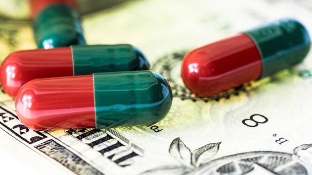 Image: Pills on money