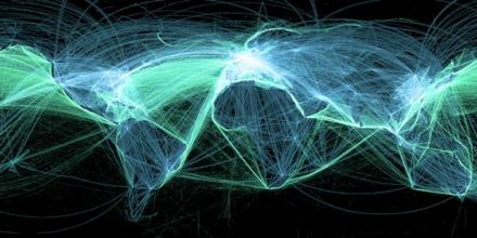 A world map showing commercial shipping routes (in green) and air traffic (in blue).