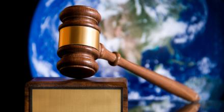 Image of gavel with a background image of Earth seen from space