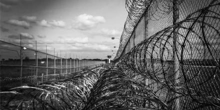 Image: Prison fence by Jody Lehign (Pixabay)