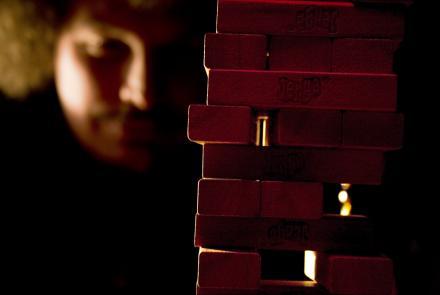 sinister dark image of jenga blocks and player