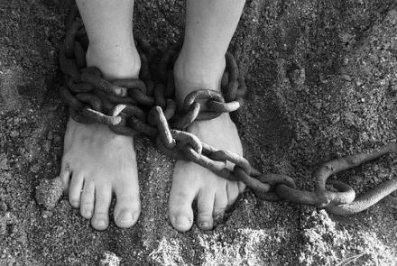 Person in chains Image by PublicDomainPictures from Pixabay under Pixabay Licence