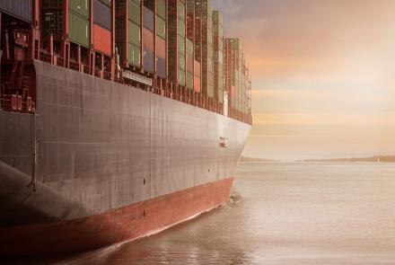 Container ship cruising on sea