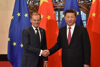 Donald Tusk, President of the European Council, on the left, shaking hands with Xi Jinping, President of the People's Republic of China at Diaoyutai State Guest House for the 18th EU-China Summit in Beijing in July 12, 2016.