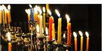Image of lit candles in menorah