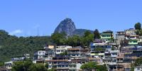 Image of favela with Christ the Redeemer in the background